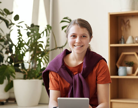 girl-smiling-while-holding-silver-ipad-4