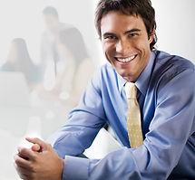 Smiling man wearing Invisalign aligner