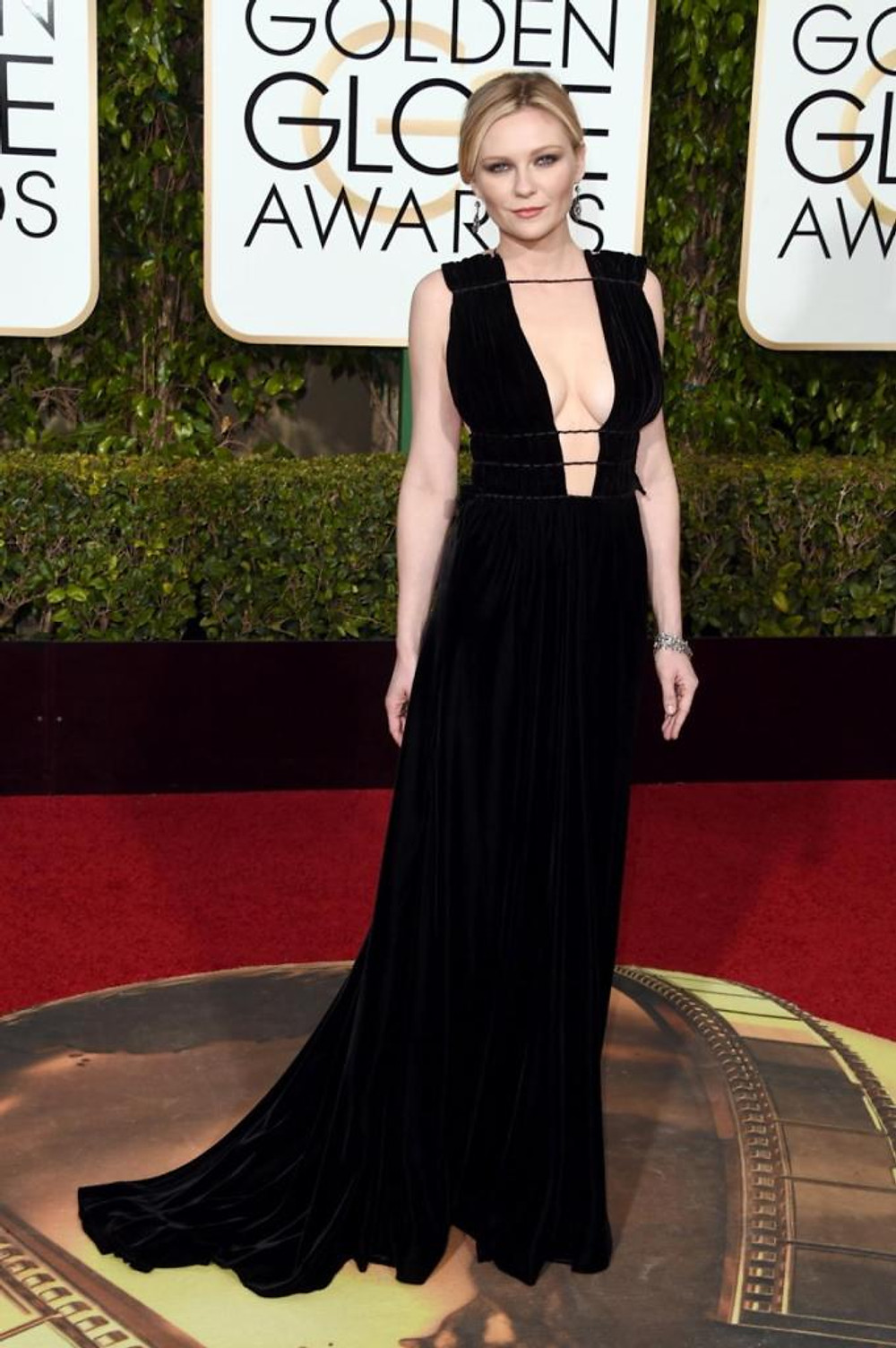 "Actress Kirsten Dunst showed off her assets in a plunging Valentino gown at the 73rd Annual Golden Globe Awards on Jan. 10, 2016. The 33-year-old actress was nominated for Best Actress in a Limited Series for her role in ""Fargo,"" but lost out to Lady Gaga."