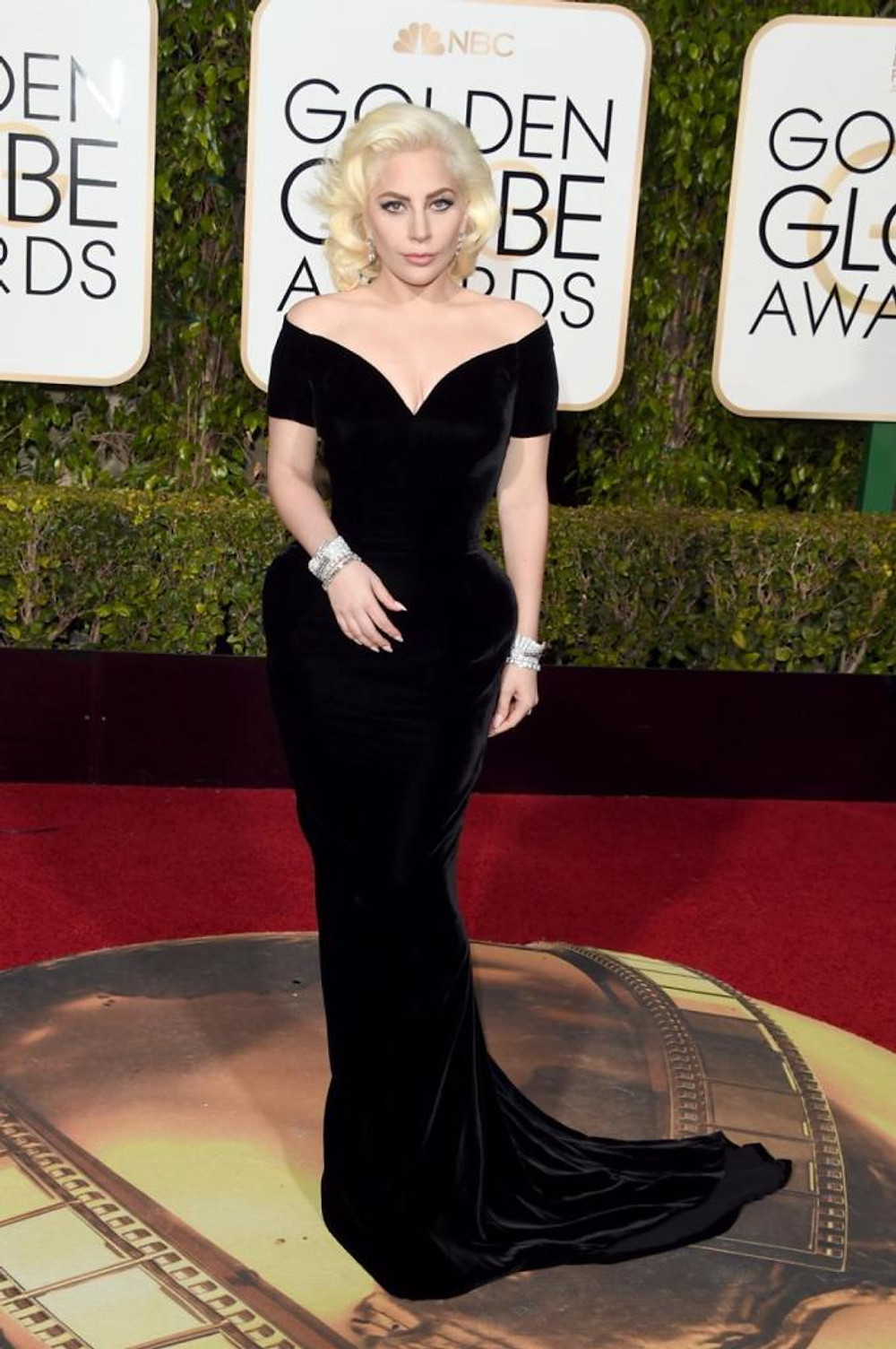 "There's nothing Gaga about this look! Lady Gaga oozed old Hollywood glamour in a stunning velvet Atelier Versace gown at the 73rd Annual Golden Globe Awards on Jan. 10, 2016. The 29-year-old entertainer won the award for Best Performance by an Actress in a Mini-Series or a Motion Picture Made for Television for her work on the series ""American Horror Story: Hotel,"" her first nomination and win as an actress."