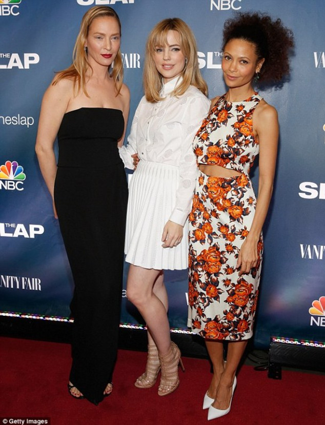 Three's company: Uma couldnwore a strapless black jumpsuit at the bash where she was joined y her co-stars Melissa George, centre, and Thandie Newson, right