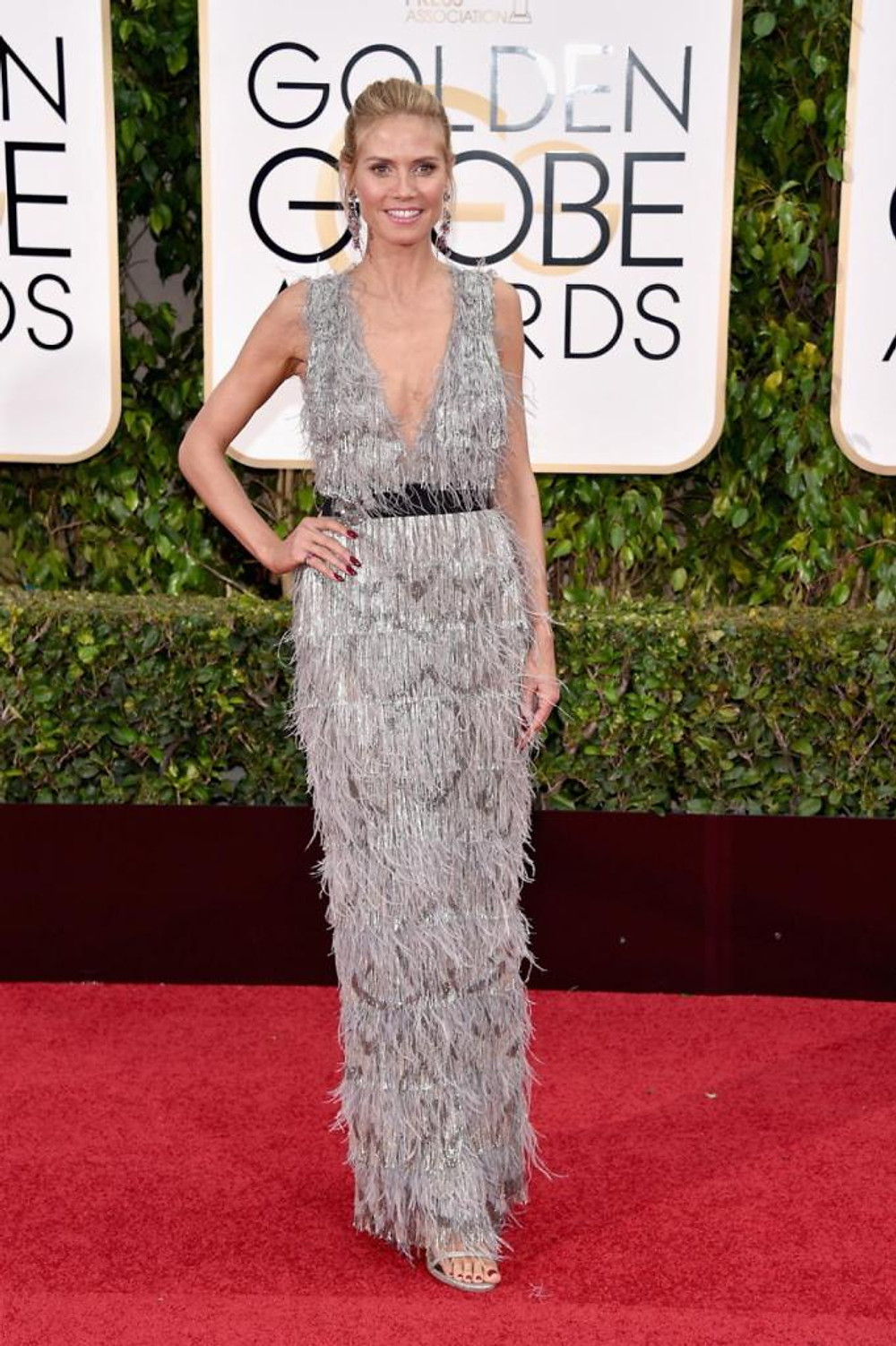 Model Heidi Klum shimmed her way on the red carpet in a beaded and feathered Marchesa gown at the 73rd Annual Golden Globe Awards on Jan. 10, 2016.