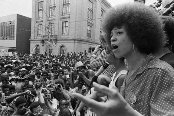 04 Jul 1974, Raleigh, North Carolina, USA --- Radical political activist Angela Davis speaks at a street rally in Raleigh. --- Image by © Bettmann/CORBIS