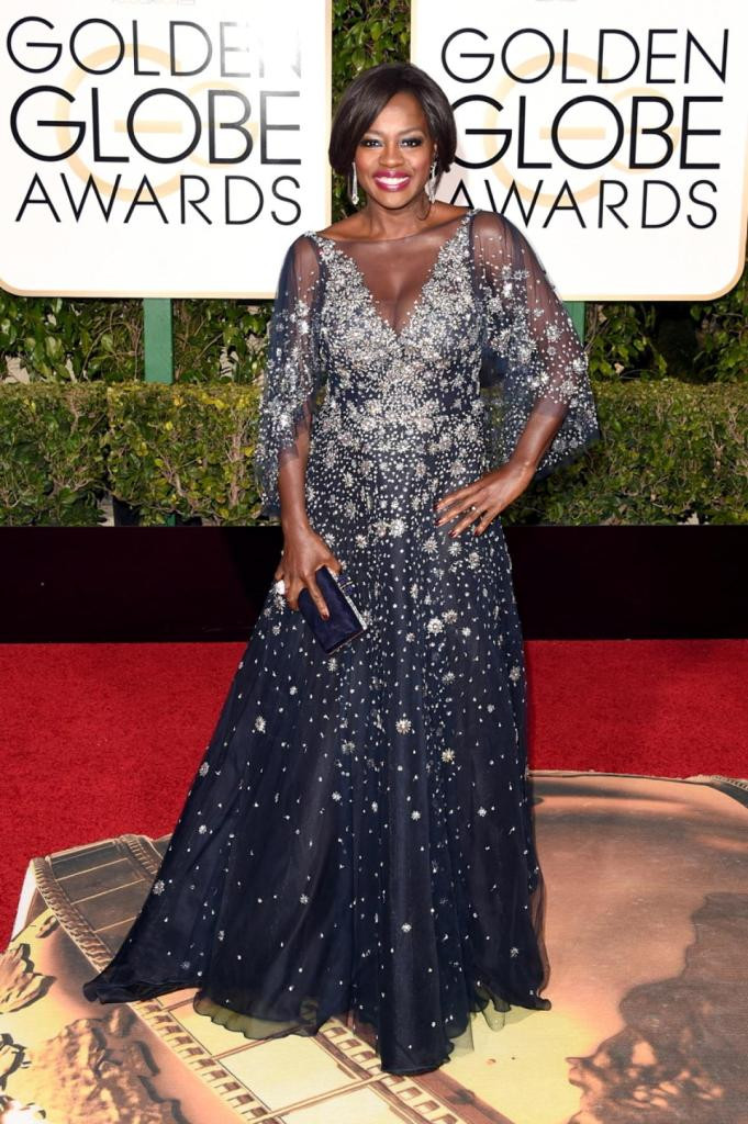 "Actress Viola Davis shined the brightest in a stunning sparkly Marchesa gown on the red carpet at the 73rd Annual Golden Globe Awards on Jan. 10, 2016. The 50-year-old actress is nominated for her work in ""How to Get Away with Murder."""