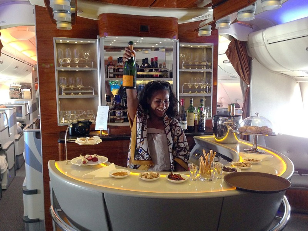 Flying is a lot more fun when you get to be the bar tender of the plane !! Yup... This is a parteyyyyy ....