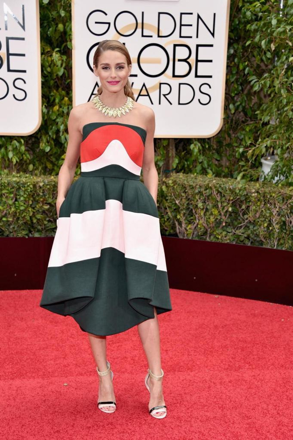 "Socialite Olivia Palermo, known for her role in ""The City,"" opted for a color block Delpozo dress of green, red and white as she arrived to the 73rd Annual Golden Globe Awards on Jan. 10, 2016."