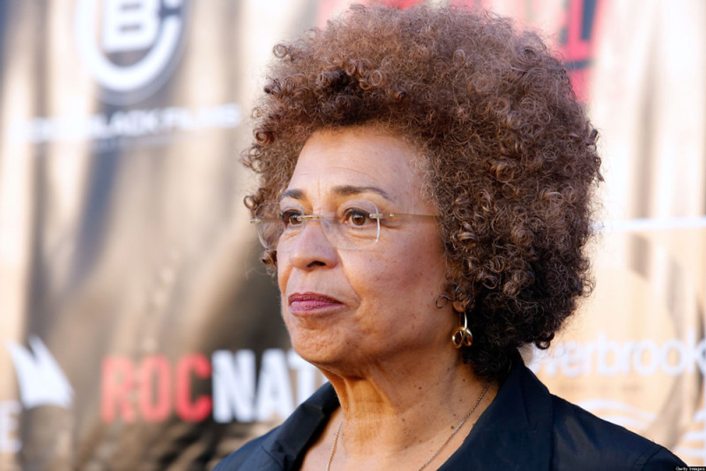 """NEW YORK, NY - APRIL 03: Activist Angela Davis attends the """"Free Angela and All Political Prisoners"""" New York Premiere at The Schomburg Center for Research in Black Culture on April 3, 2013 in New York City. (Photo by J. Countess/Getty Images)"""