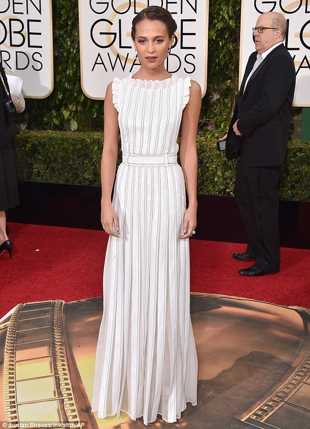 Alicia Vikander was angelic in a delicate white dress as she arrived at the Beverly Hilton Hotel for the 2016 Golden Globe Awards