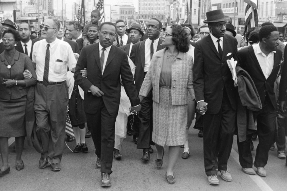 **ADVANCE FOR WEEKEND JUNE 7-8**This photo supplied by the High Museum of Art, shows Dr. Martin Luther King Jr. and his wife Coretta Scott King leading freedom marchers in Montgomery, Ala. in 1965, in a photo by Morton Broffman, which is part of one of two exhibits --this one at the High Museum of Art -- opening in Atlanta on Saturday,June 7, 2008,   focusing on the civil rights movement.(AP Photo/ High Museum of Art ,Gift of the Broffman Family,Morton Broffman)