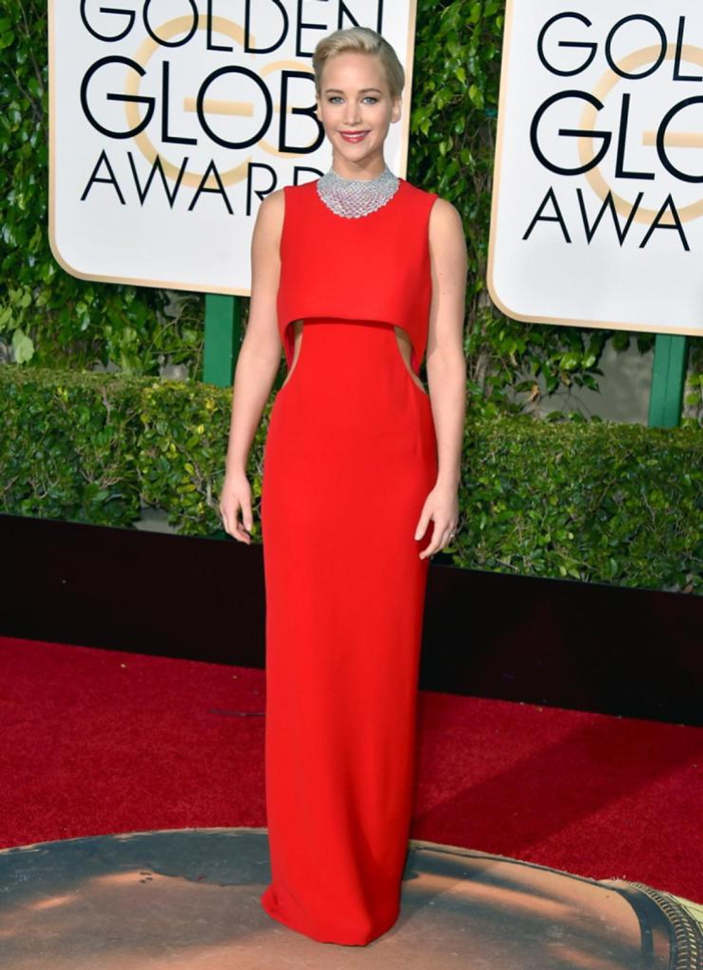 "Jennifer Lawrence, who took home the award for best actress for her film ""Joy,"" looked red hot in a striking cut-out Dior gown at the 73rd annual Golden Globe Awards on Jan. 10, 2016."