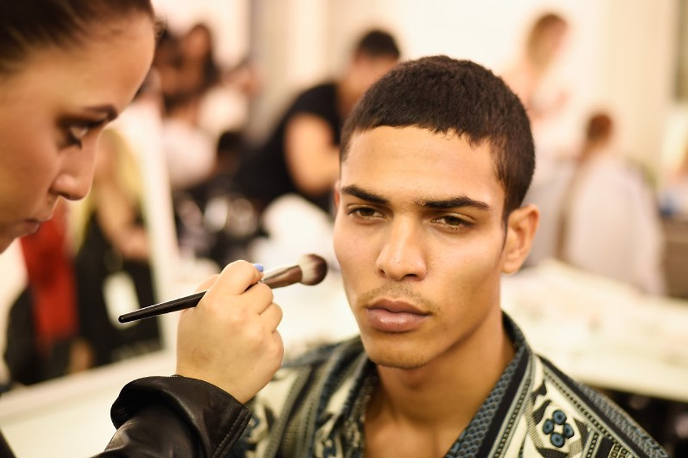 PARIS, FRANCE - SEPTEMBER 28:  A model prepares backstage during FENTY x PUMA by Rihanna at Hotel Salomon de Rothschild on September 28, 2016 in Paris, France.  (Photo by Victor Boyko/Getty Images for Fenty x Puma)