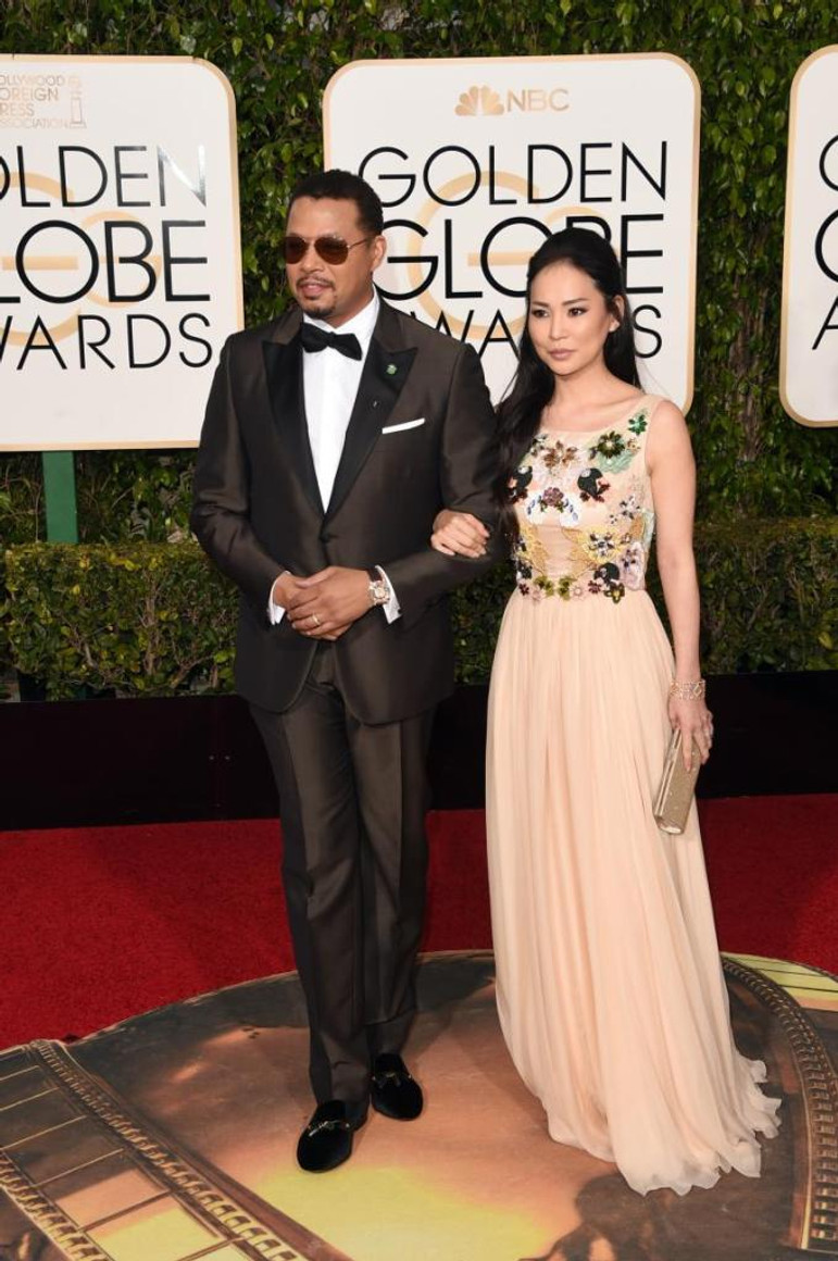 """Empire"" star Terrence Howard and wife Mira Pak on the Golden Globes red carpet in Beverly Hills, California, on Jan. 10, 2016."