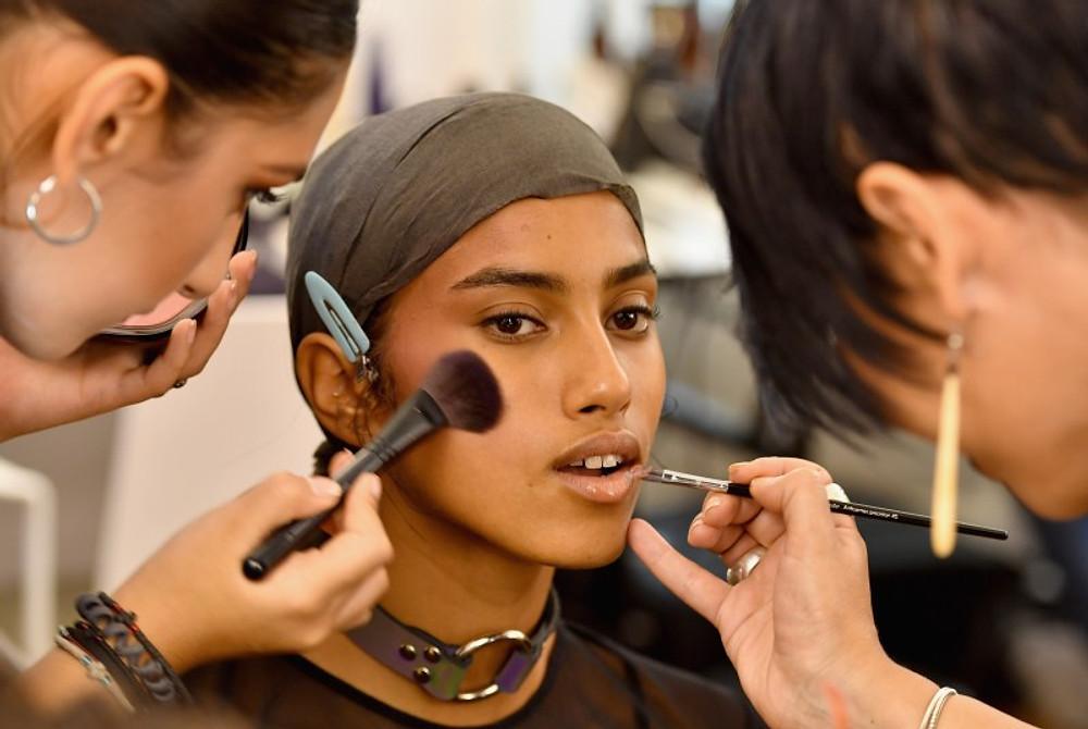 A model prepares backstage during FENTY x PUMA by Rihanna at Hotel Salomon de Rothschild on September 28, 2016 in Paris, France.