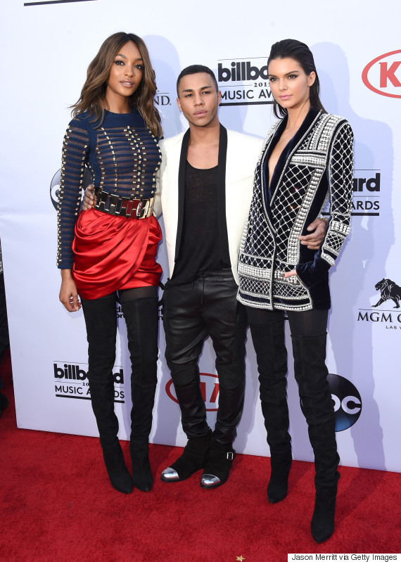 LAS VEGAS, NV - MAY 17:  (L-R) Model Jourdan Dunn, designer Olivier Rousteing and model Kendall Jenner, all wearing Balmain x H&M, attend the 2015 Billboard Music Awards at MGM Grand Garden Arena on May 17, 2015 in Las Vegas, Nevada.  (Photo by Jason Merritt/Getty Images)