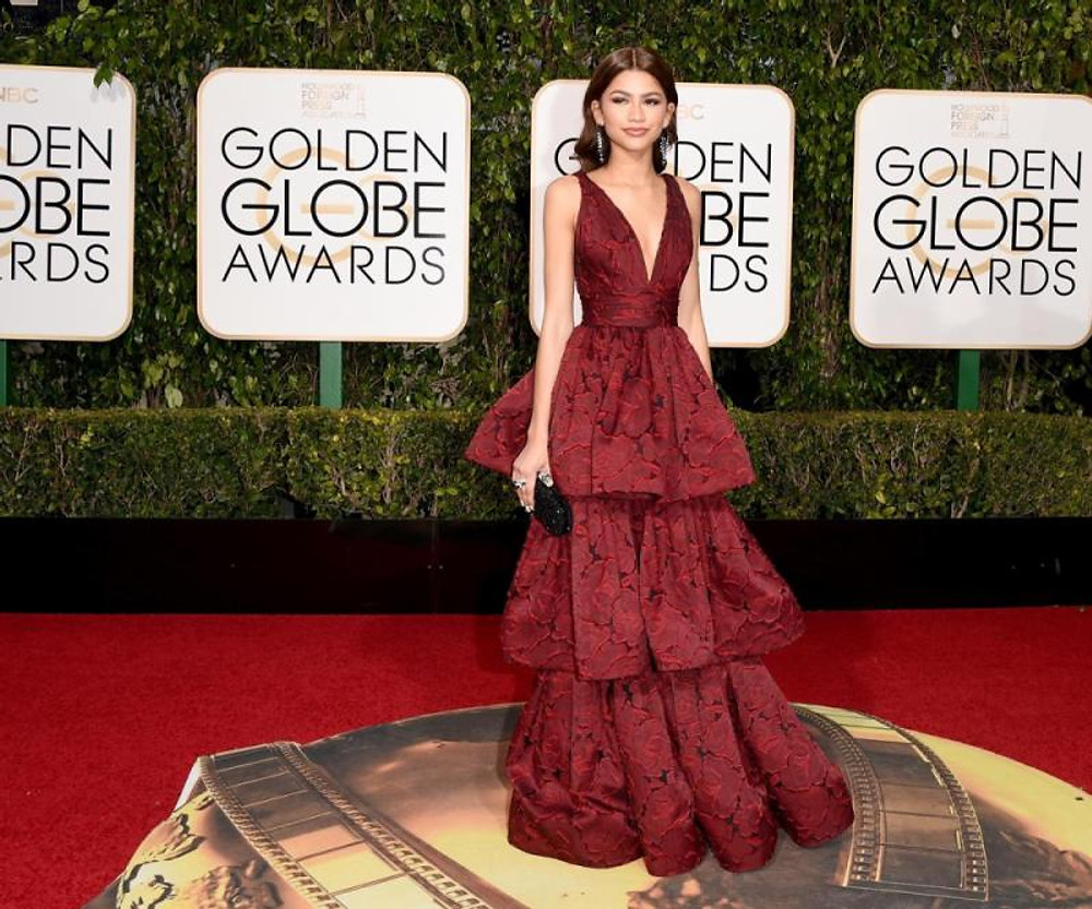 Zendaya donned a striking red tiered Marchesa gown complete with floral embellishments at the 73rd Annual Golden Globe Awards held at the Beverly Hilton Hotel on Jan. 10, 2016 in Beverly Hills, California.