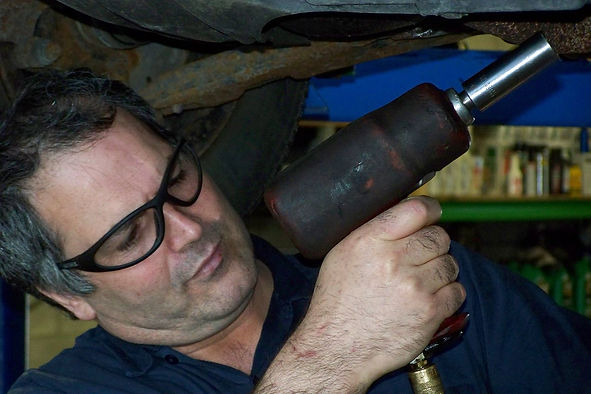 owner/head mechanic Mike Kouhi