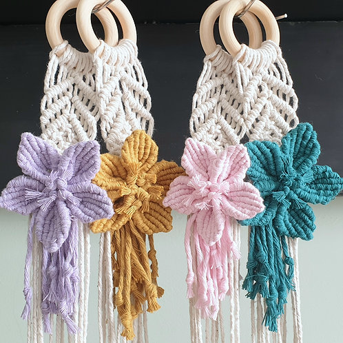 Macrame plant hanger with flower accent