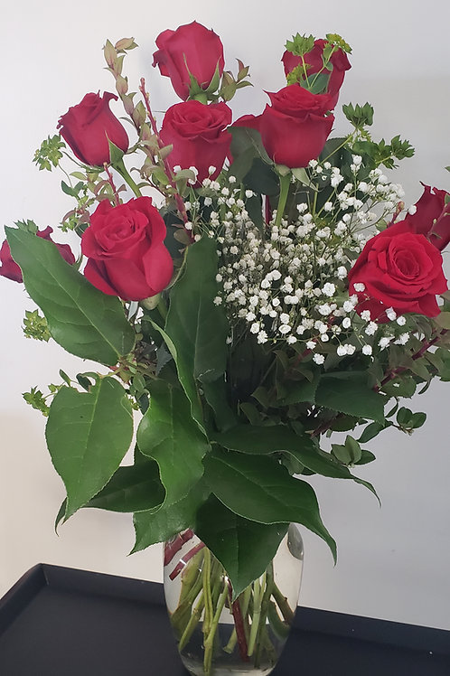 True Love,( one dozen long stemmed Roses in a vase