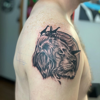 Lion with compass