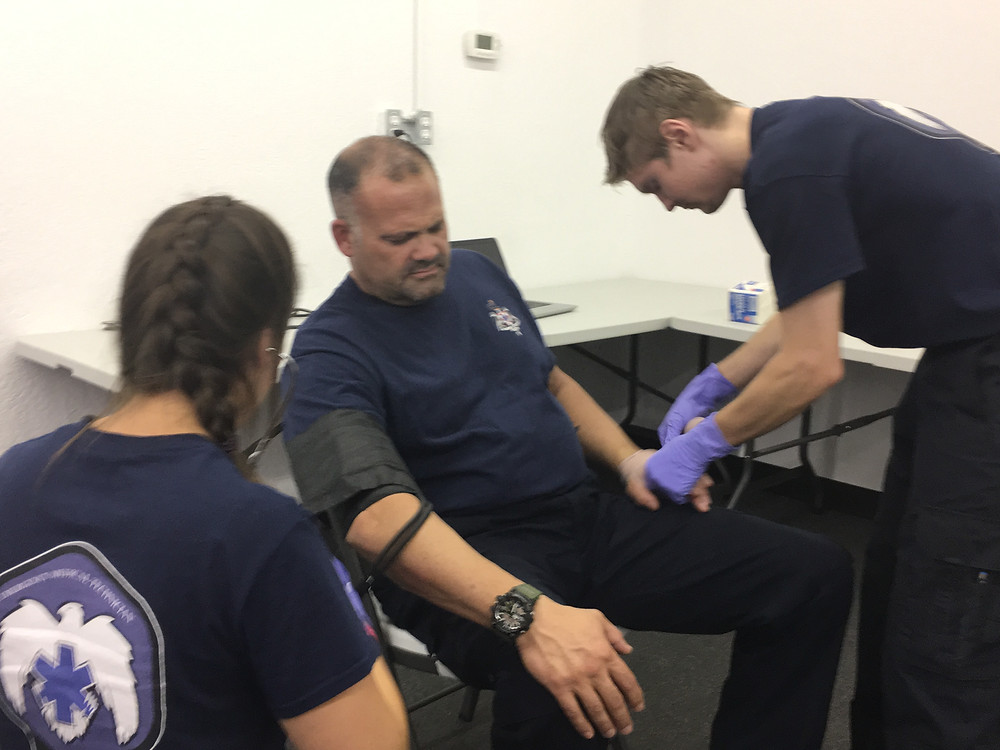 EMT Students practicing vitals.