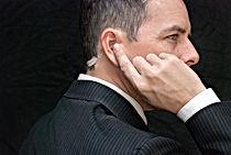 Close-up of a secret service agent liste