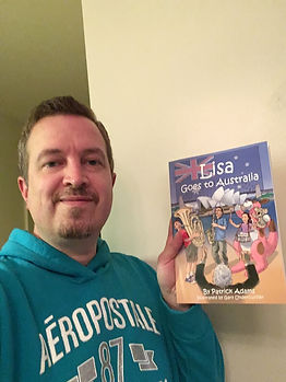 Patrick Adams with Lisa Goes to Australia Book