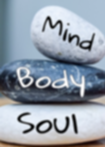 Picture of three stacked rock with mind, body, spirit