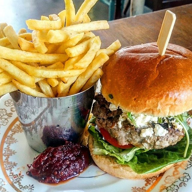 Our Lamb and Cumin Burger with Crushed Garlic and Mint Feta, Burnt Onion Ketchup, Dill Pickle, Baby