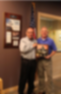 Mark Hellinger receiving Varco Pruden's Hall of Fame Award for Best of Category on behalf of CME Corporation, presented by Troy Smith.