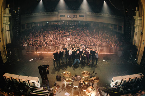The band, management and crew celebrate on the stage at Brixton Academy at the end of Bullet For My Valentine's EU and UK 2016 Venom tour. - London