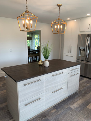 Removed a wall to create an open entry into this beautiful kitchen with large island.