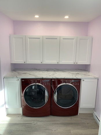 Removed a closet to build this bright and spacious laundry room.