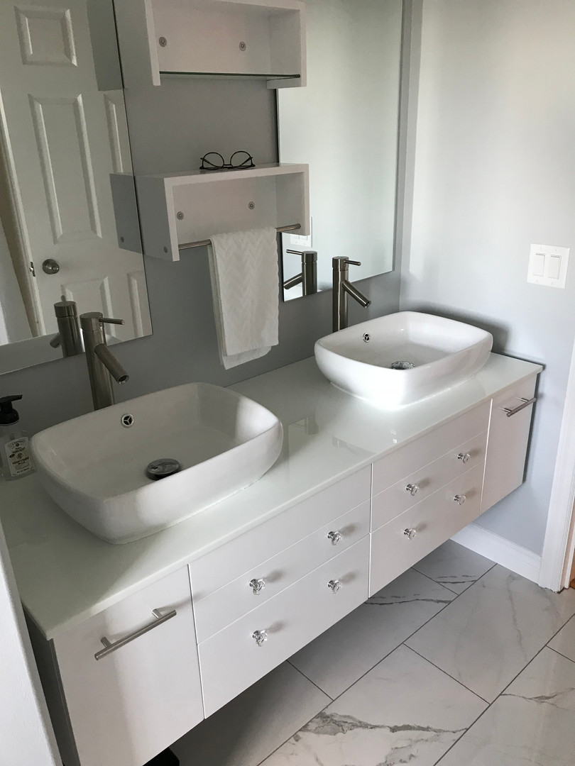 Marble flooring, trim and vanity install.