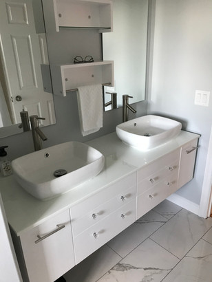 Marble flooring, trim and vanity install.