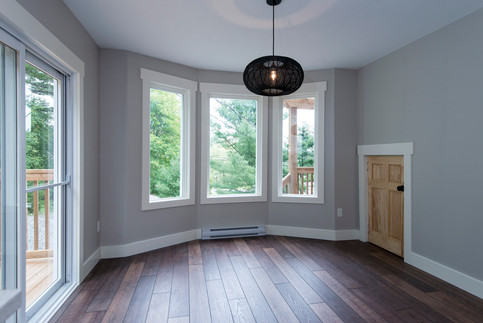 Removed an old, unfunctional addition off this area, creating a  perfect dining space.