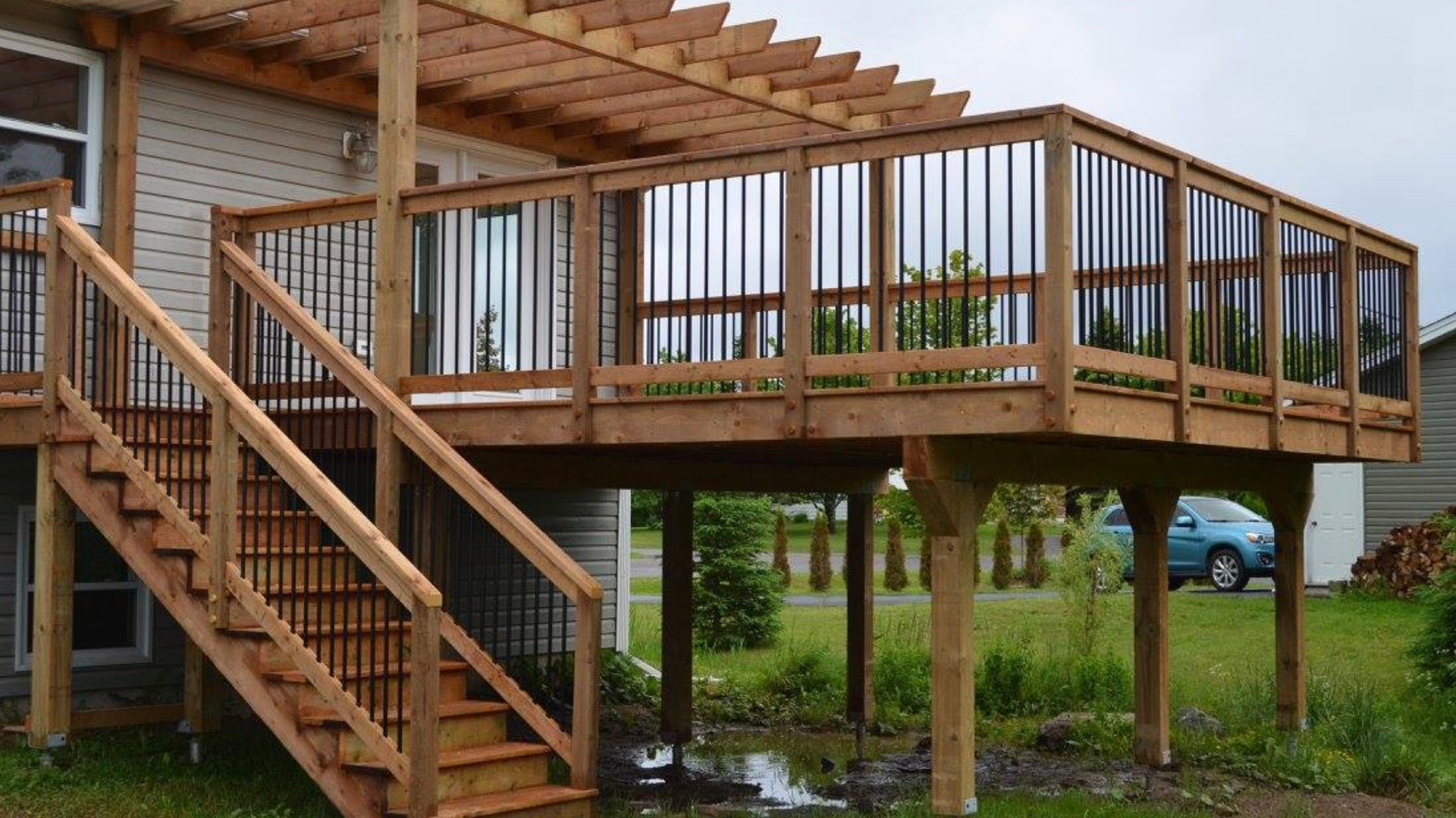 16x20 deck with pergola on helico piles with mortise and tenon joints.