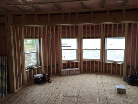 Curved wall framing created a year round living space from a three season space.