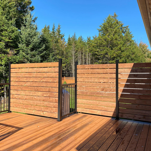 Duralife decking with hidden stepclip fastening and privacy panels.