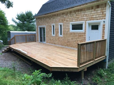 New windows, doors, cedar siding and decking.