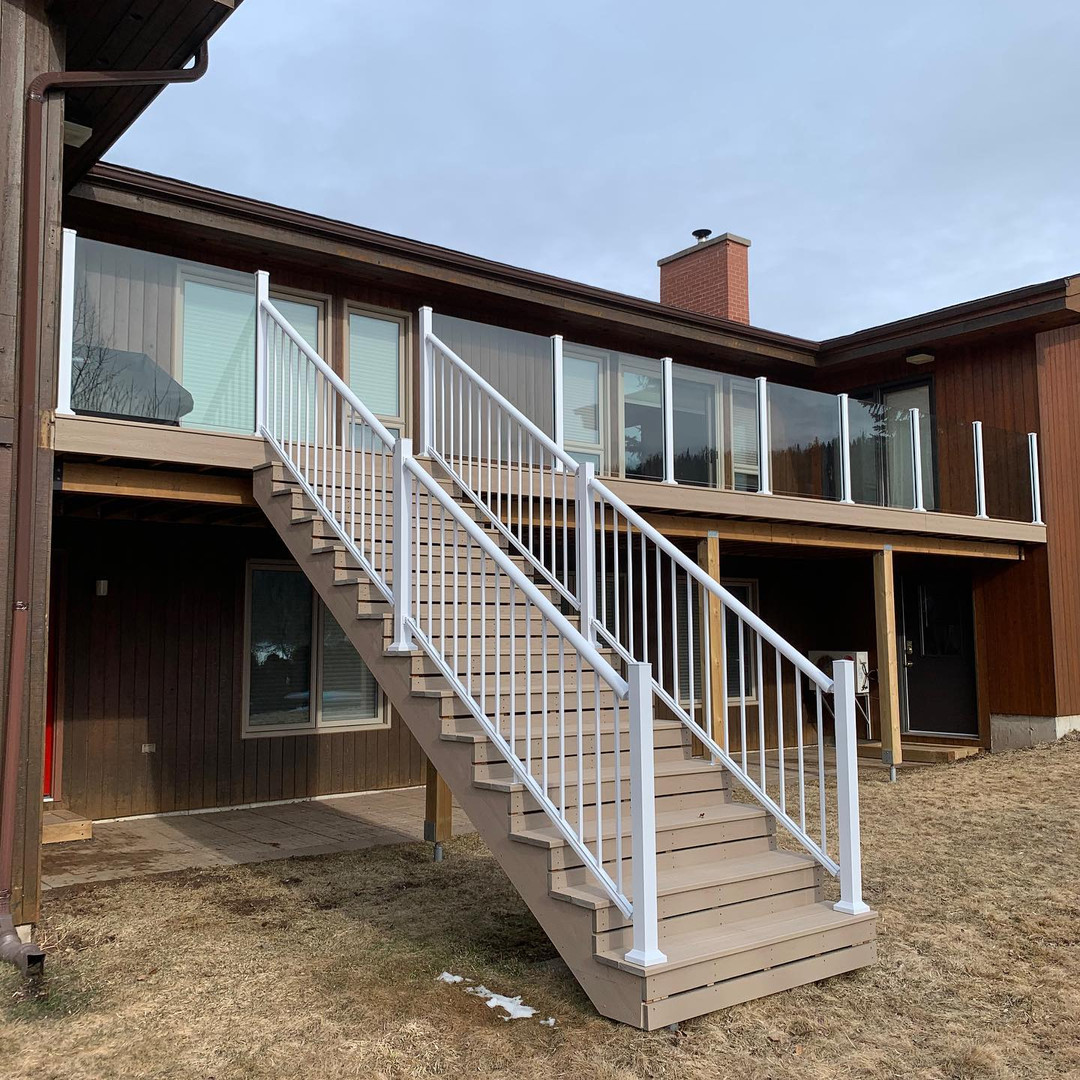 11x36 trex composite decking with century scenic glass railings for a perfect view of the river.