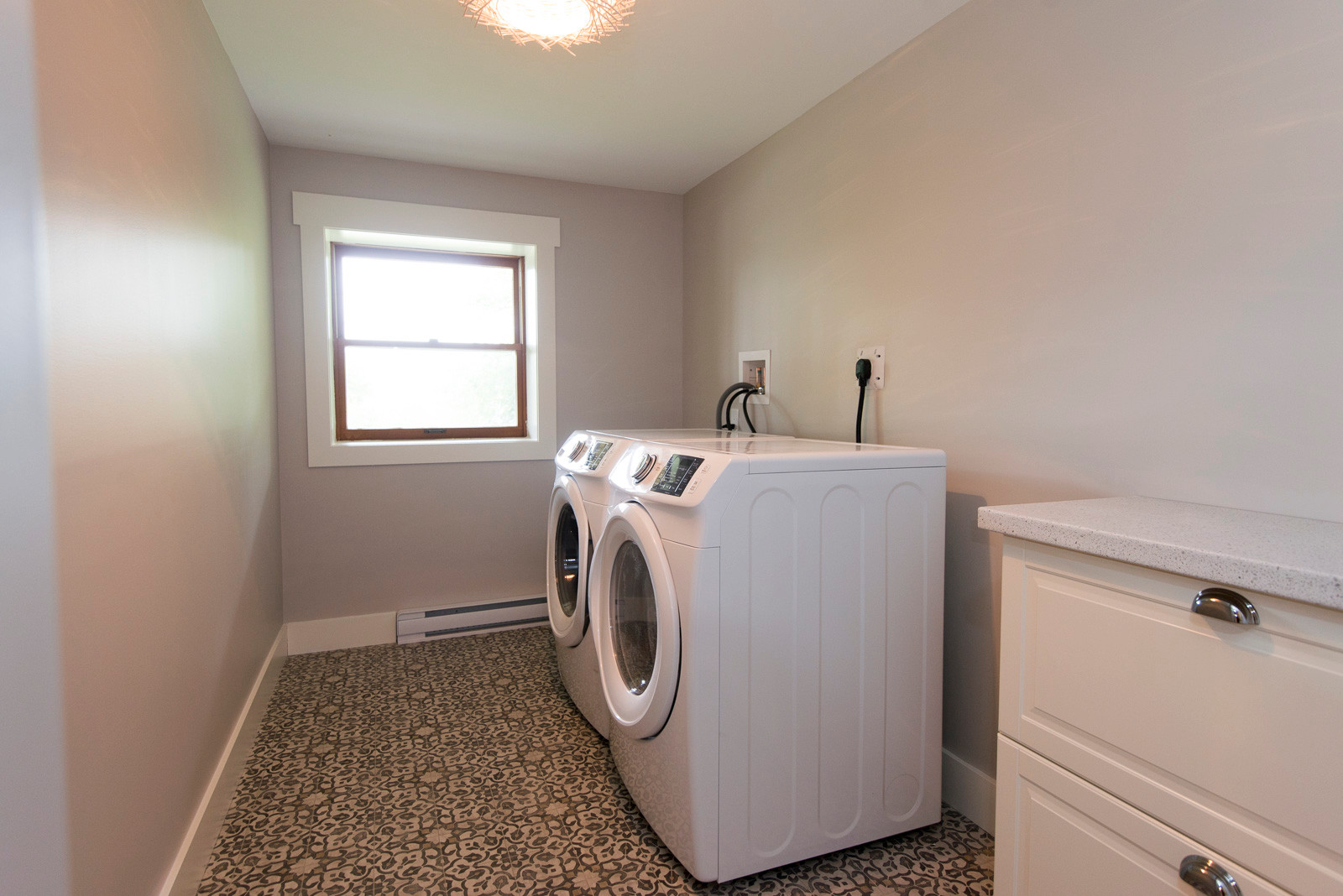 This large laundry room was created in the basement development of this 100 year old home.