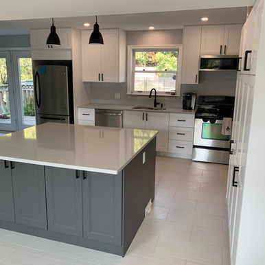 Wall removal and full renovation created this functional, bright kitchen.