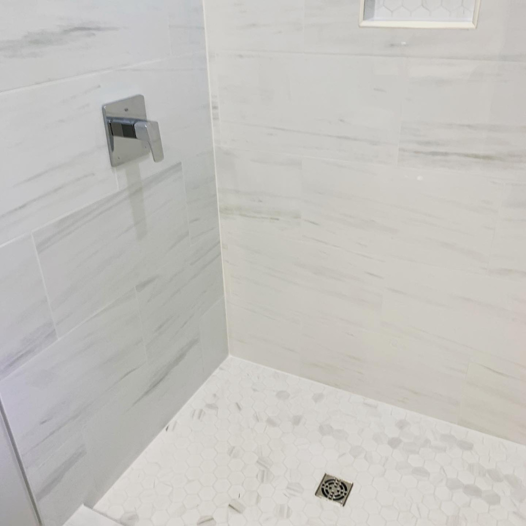 Custom shower size with sloped base.