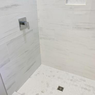 Custom shower size with sloped base.