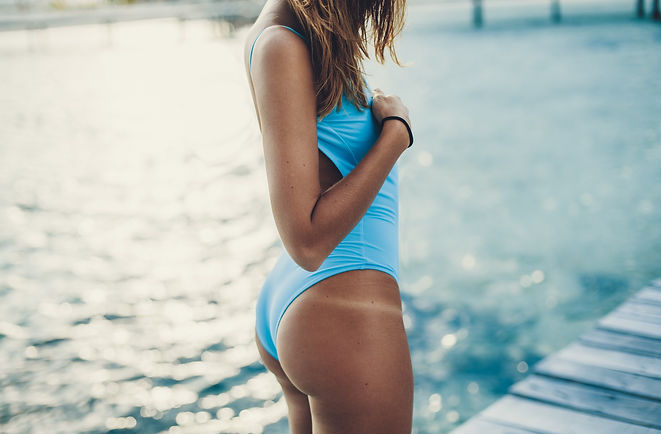 Young woman with tan lines