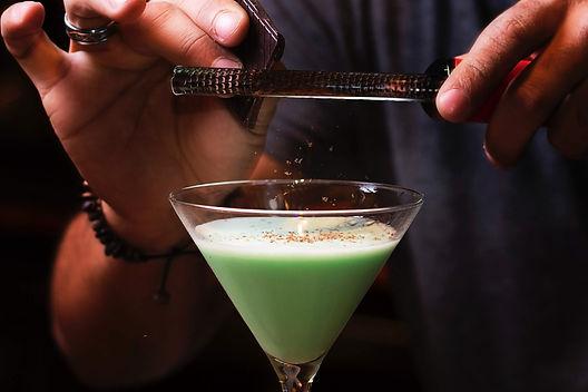 Mixologist crafting Martini
