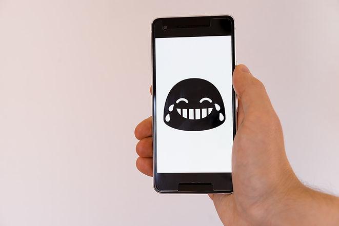 Laughing emoji on smartphone