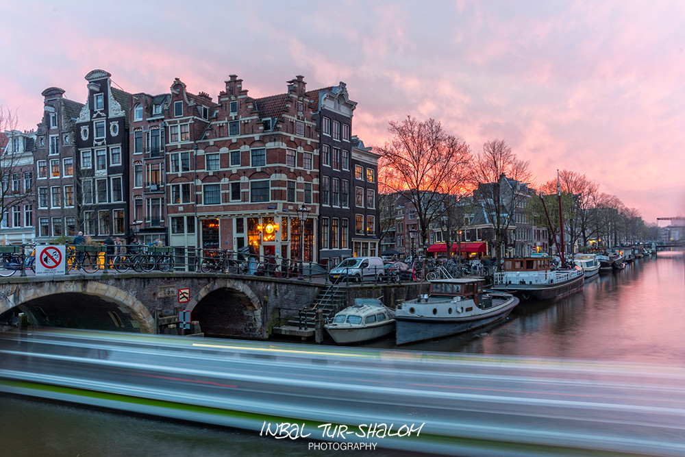 long exposure, boat on the canal on an evening in Amsterdam