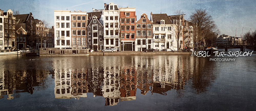 Amstel river and typical Dutch houses in Amsterdam