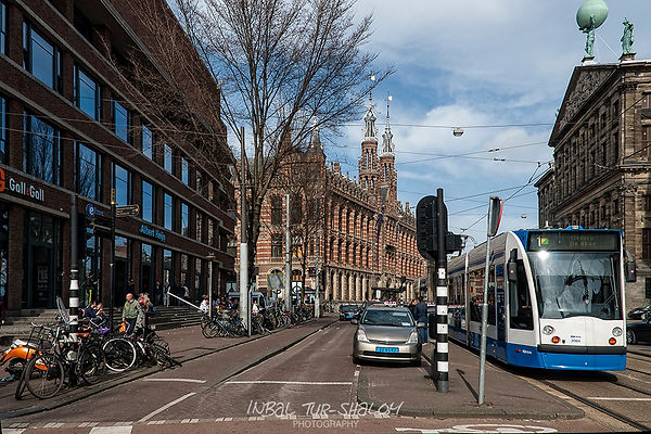 Tram and taxi behind the royal palace in Amsterdam